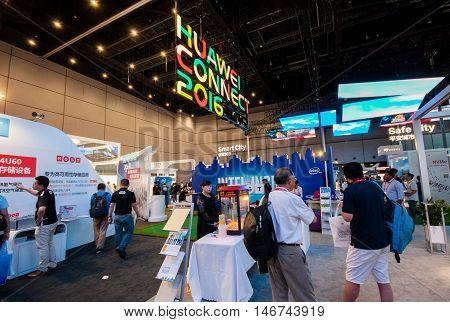 SHANGHAI CHINA - AUGUST 31 2016: Attendees of Huawei Connect 2016 information technology conference at Expo Center exhibition hall in Shanghai China on August 31 2016.