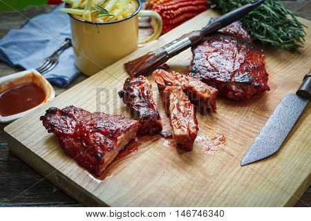 Home made pork bbq ribs with french fries on table