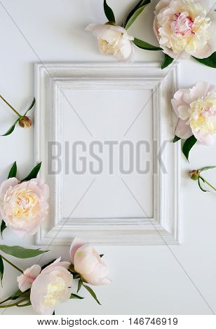 Wedding invitation or bridal shower invitation or Mother's Day card mockup white wooden frame decorated with flowers blank space for a text