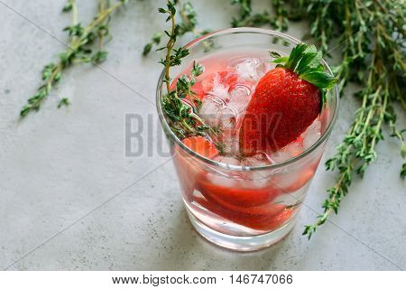 Straberry and thyme cocktail alcoholic or non-alcoholic drink or infused water