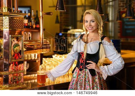 Young waitress in uniform in a bar