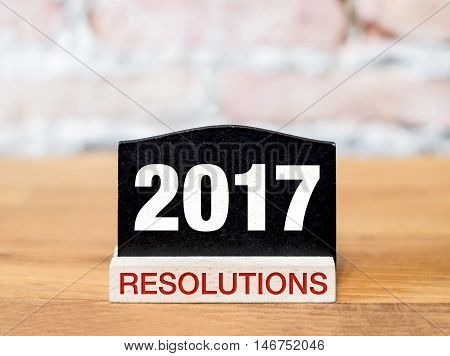 New Year 2017 Resolutions Text On Blackboard Sign On Wood Table At Brick Wall, Goal Plan For Year