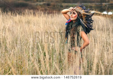 Native American Indian Girl Dressed In National Clothes And Looking At The Summer Field