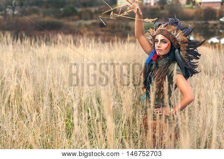 Girl Dressed In Native American Indian Clothes Throw Up Wheat Ears In The Field