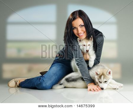 Woman And Puppies