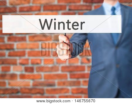 Winter - Businessman Hand Holding Sign
