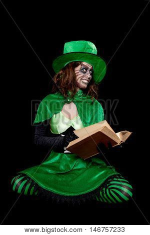 Green Goblin Is Reading From A Book, Black Background, Concept Fairytales And Legends