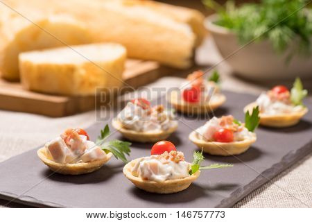 canapes appetizer with creamy Chicken salad served on a slate plate