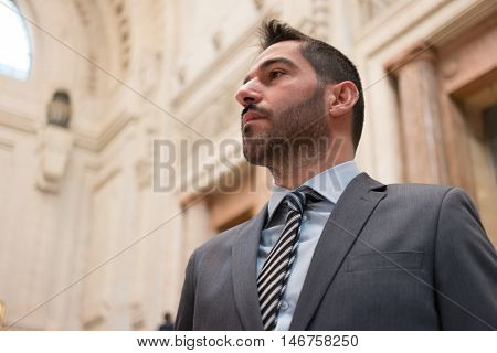 Portrait of a confident businessman in an ancient building