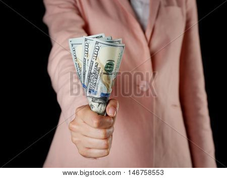 Woman with money on black background