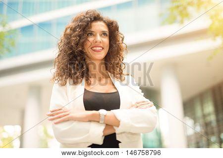 Portrait of a smiling businesswoman. Bright light effect