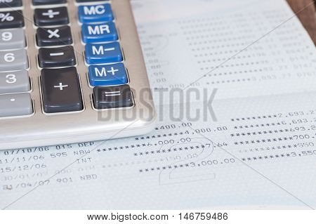 Old calculator on book bank on background