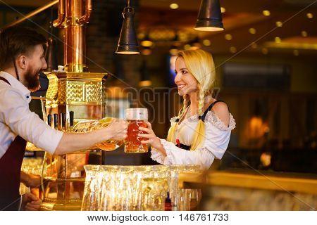 Smiling waitress with mug indoors