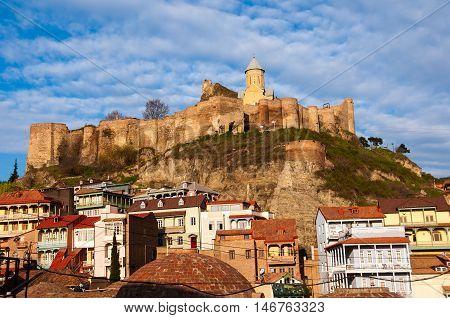 Narikala castle over old Tbilisi Georgia with cloudy blue sky