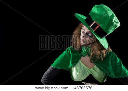 Leprechaun Girl Looking To Copyspace, Black Background, Concept St. Patrick´s Day