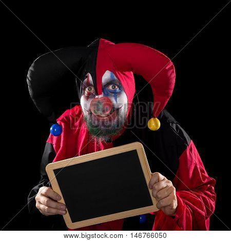 Jester Holding A Slate With Copyspace, Black Background