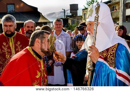 Perechin - Transcarpathia - Ukraine-11 September 2016: The local priest kisses Chrest away with Patriarch of the Ukrainian Orthodox Church Kiev Patriarchate Filaret before the consecration of a new wooden church.