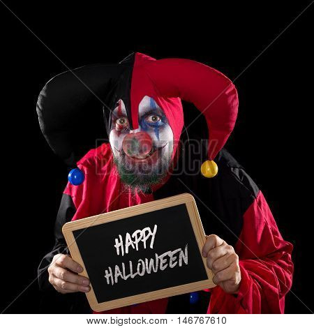 Jester Holding A Slate With Text Happy Halloween, Black Background