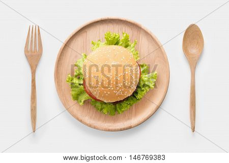 Eating Bbq Burger On Wooden Dish Isolated On White Background. Clipping Path Included Isolated On Wh