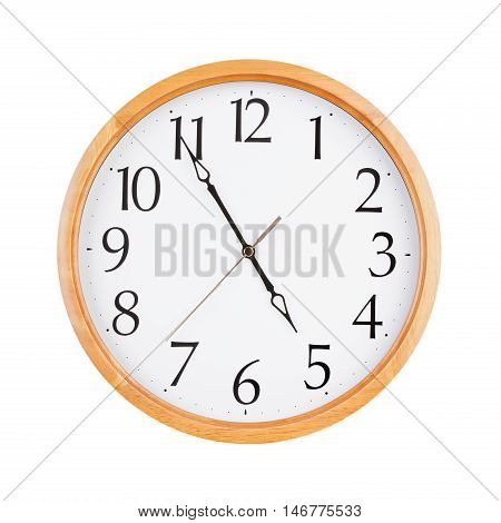 Almost five o'clock on a large round clock