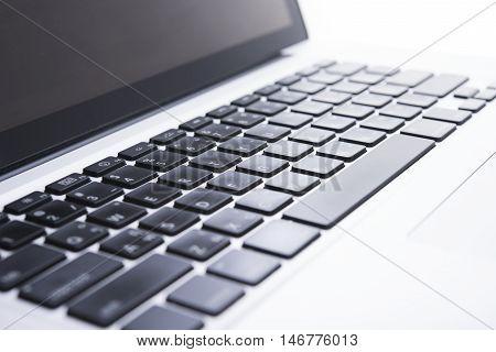 Close up computer keyboard on desktop office of a modern laptop.