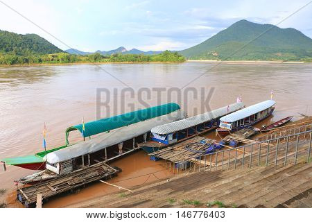 The transportation on the river border between Thailand and Laos under the afternoon sun light - Kong river border