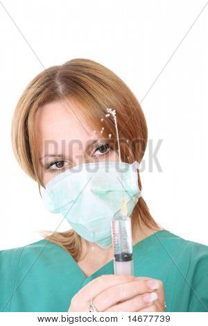 Friendly nurse holding a syringe