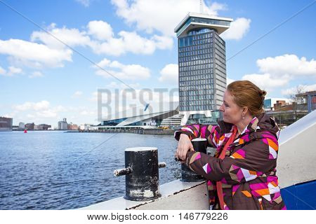 Native dutch woman on a ferry in Amsterdam the Netherlands