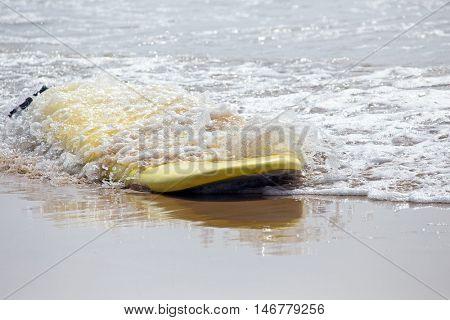 Surfboard floating in the atlantic ocean