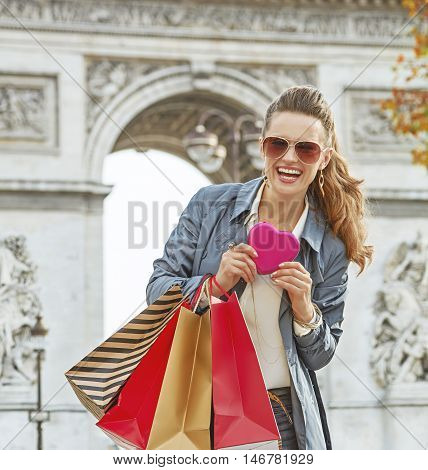 Woman With Shopping Bags Near Arc De Triomphe In Paris, France