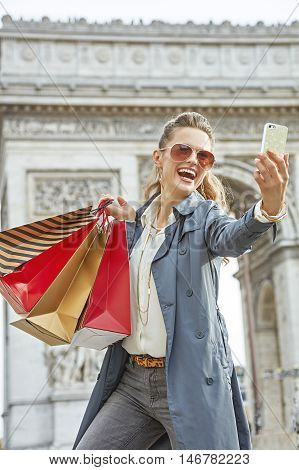 Woman Shopper Near Arc De Triomphe Taking Selfie With Cellphone