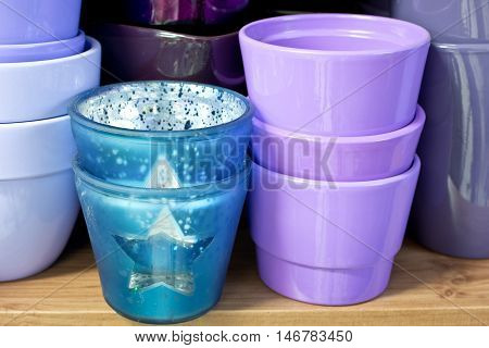 new violet flowerpots in a shelf in a market