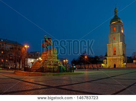 Bohdan Khmelnytsky monument and bell tower of Saint Sophia's Cathedral night scene. Kiev Ukraine.