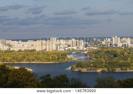 Hydropark and Kiev left side at autumn. Blue Dnepr river in the middle of composition.