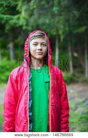 Portrait teenager hiker clothing jacket with hood in wild life.