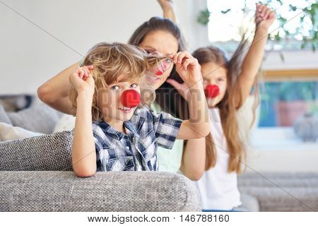 Happy family with red nose having fun during carnival