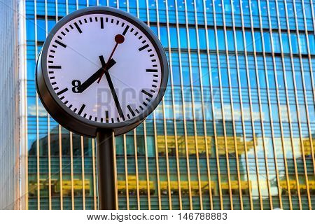 Public clock in Canary Wharf financial district in London