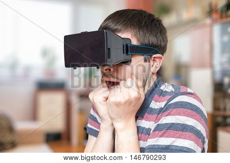 Young Man Is Wearing 3D Virtual Reality Glasses And Is Scared.