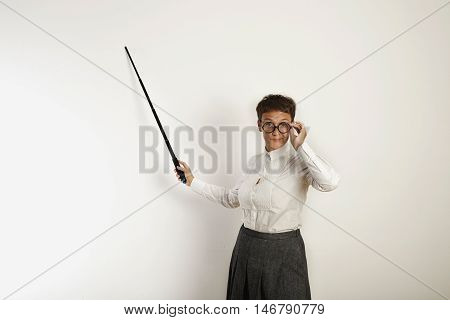Female Teacher With A Pointer At White Board