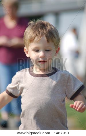 Boy Running From An Adult