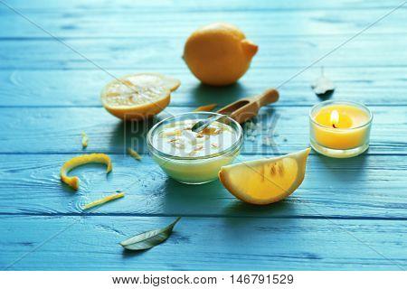 Natural scrub ingredients on blue wooden background