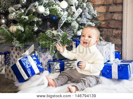 Funny one year old baby baby boy on bright festive background. Christas time