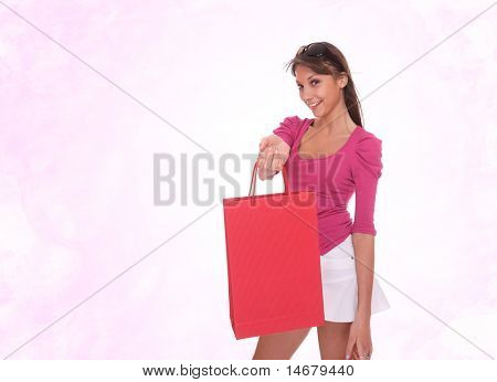 Portrait of young cute shopaholic girl on pink studio background