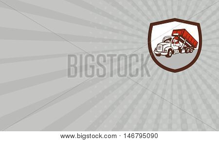 Business card showing illustration of a roll-off bin truck driver smiling with thumbs up viewed from front set inside shield crest done in cartoon style.