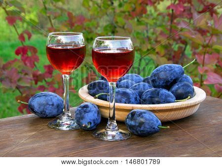 Plum Drink In A Glass Wineglass With Plums