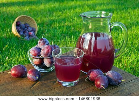 Prune Juice In The Carafe And Glass With Plums
