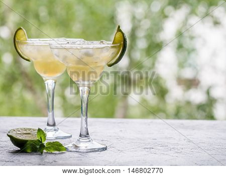 margarita cocktail with lime on nature background