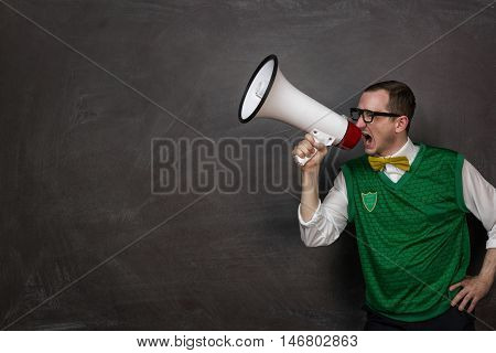 Funny retro nerd yelling through the megaphone with copy space