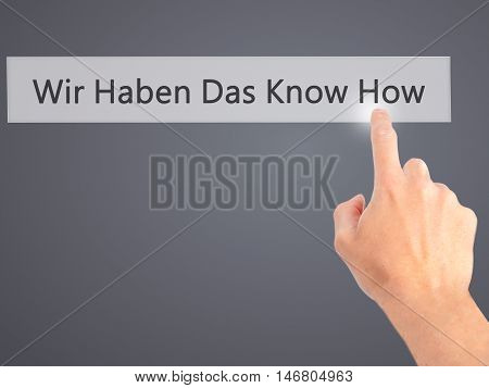 Wir Haben Das Know How! (we Have The Know-how In German) - Hand Pressing A Button On Blurred Backgro