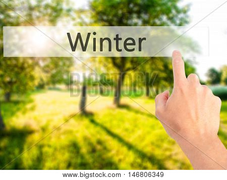 Winter - Hand Pressing A Button On Blurred Background Concept On Visual Screen.